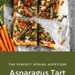 asparagus tart cut into triangles topped with roasted carrots and fresh herbs
