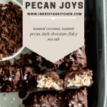 overhead shot of pecan joy candy bars with a bowl of chocolate shavings and the middle of one of the bars exposed
