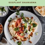 overhead shot of eggplant shawarma with tomatoes, olives, onions, cilantro, tzatziki and schug sauce
