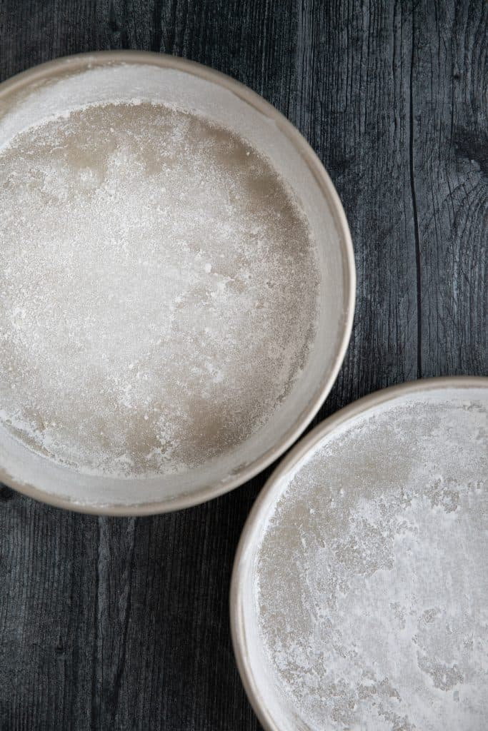 two 8 inch pie pans sprayed and floured