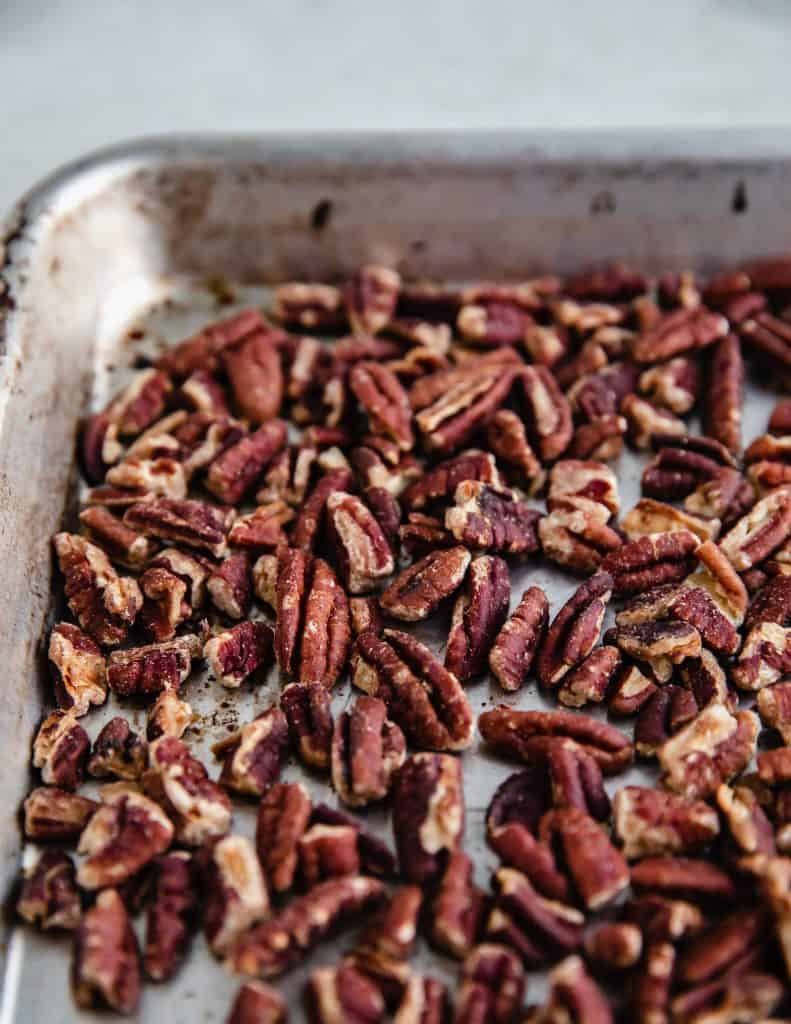 toasted pecans on a sheet tray