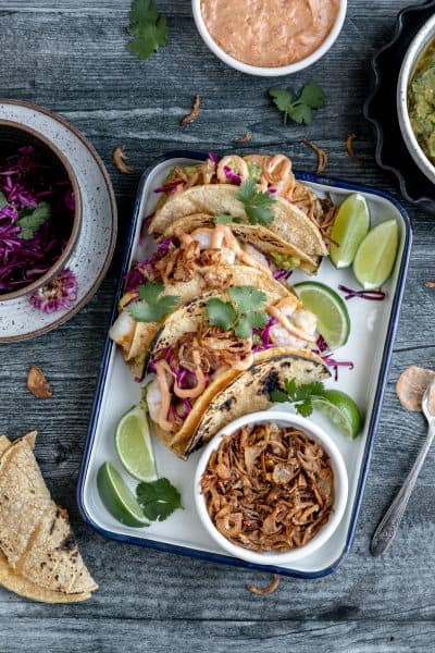 shrimp tacos with limes and crispy fried shallots