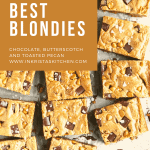 close up of a whole pan of blondies cut into squares with chocolate chunks, butterscotch chips and flaky sea salt on top