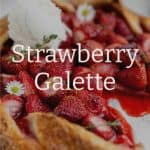 close up 45 degree angle shot of strawberry galette garnished with honey vanilla ice cream, daisies and thyme