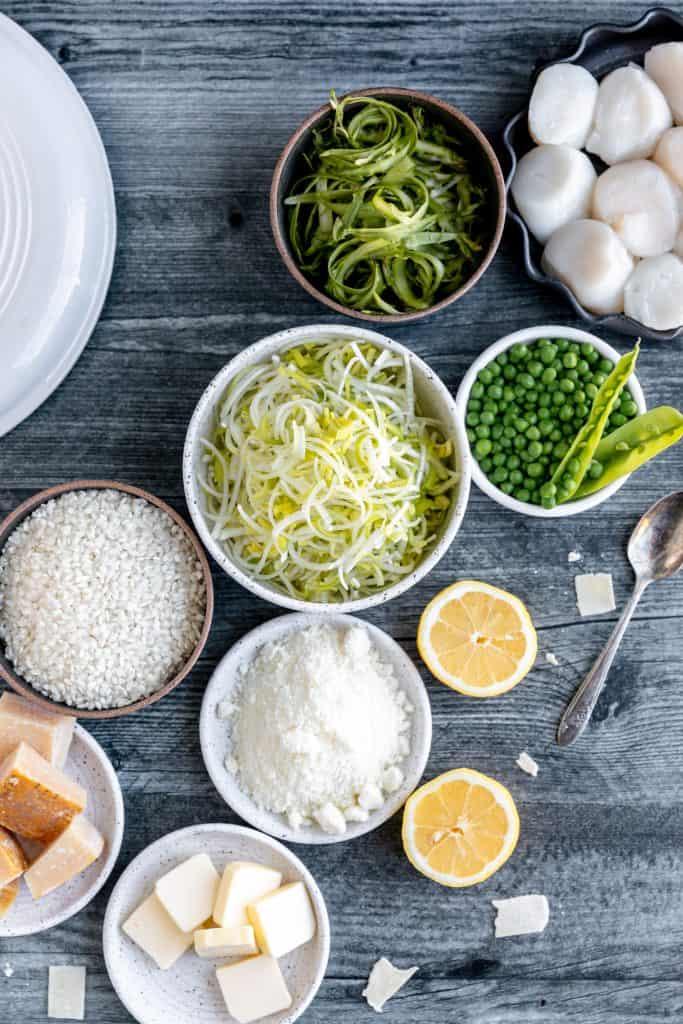 scallops, arborio rice, lemon, romano cheese, peas, asparagus, parmesan rinds