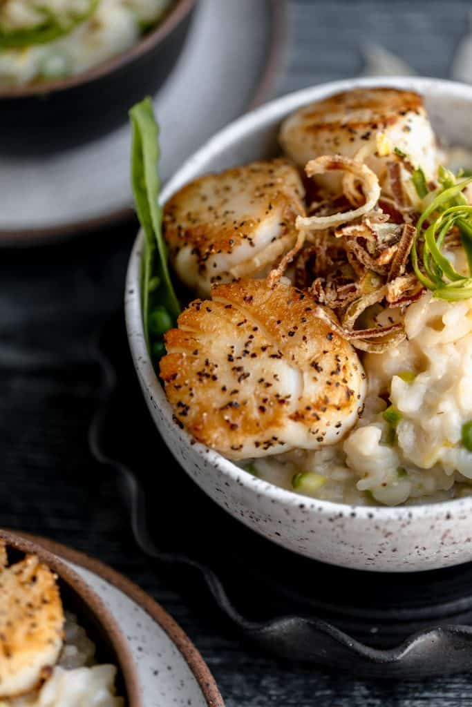several bowls of scallops and risotto