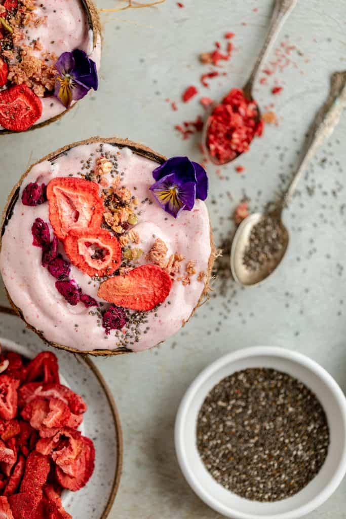smoothie bowl with chia seeds and freeze dried strawberries on the side