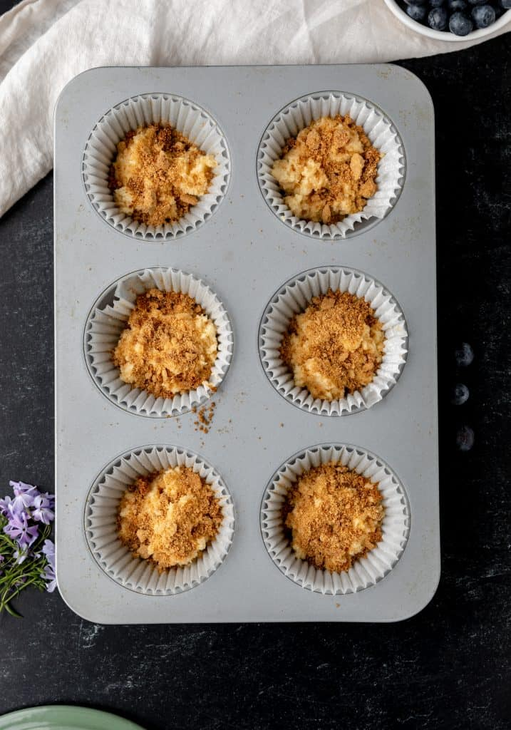 blueberry muffins with streusel layered in the middle