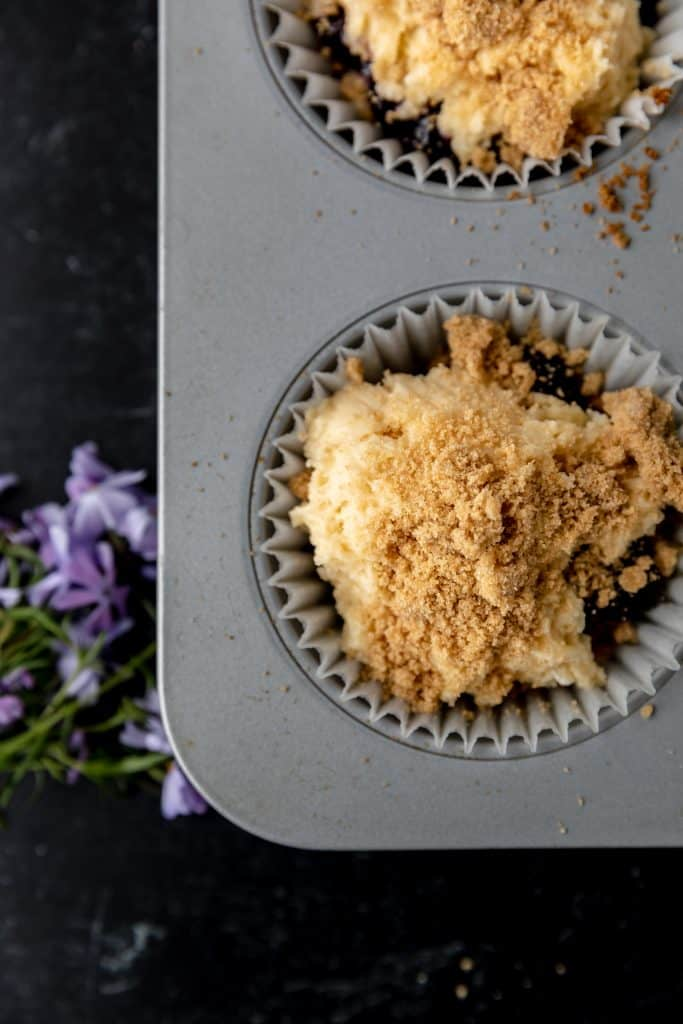 raw blueberry muffins with streusel on top