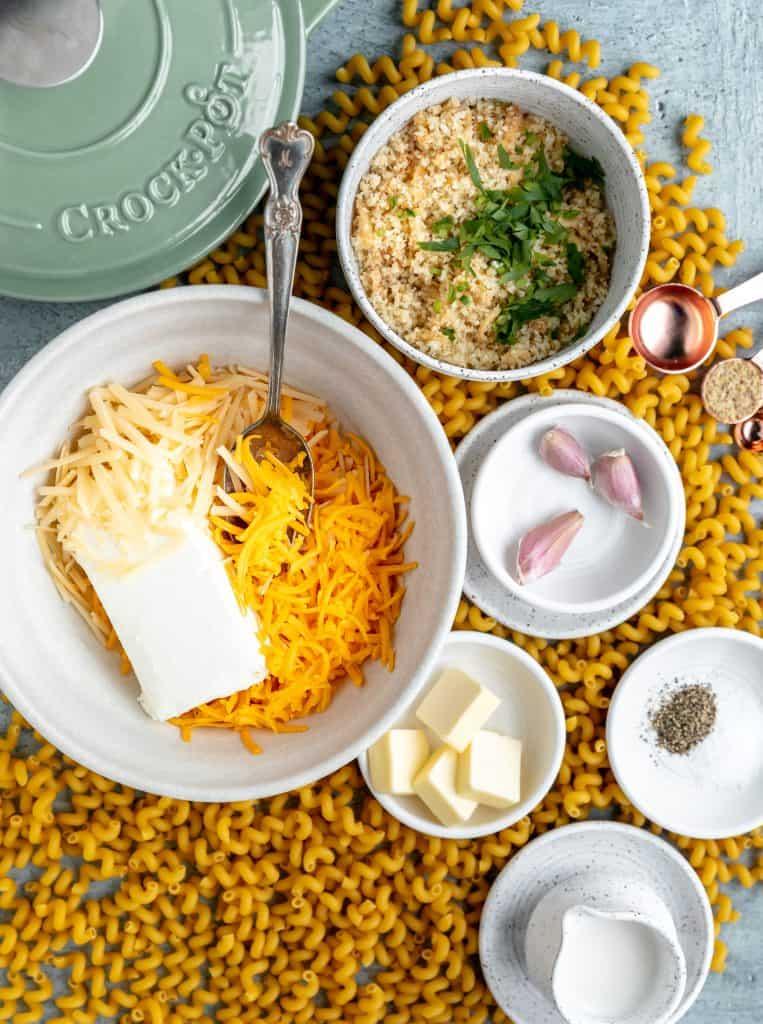 3 cheeses, pasta, herbed bread crumbs, garlic cloves, butter, salt, pepper and milk