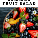 close up of summer fruit salad garnished with mint