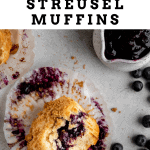 blueberry streusel muffin with a bite taken out of it lying unwrapped on its side