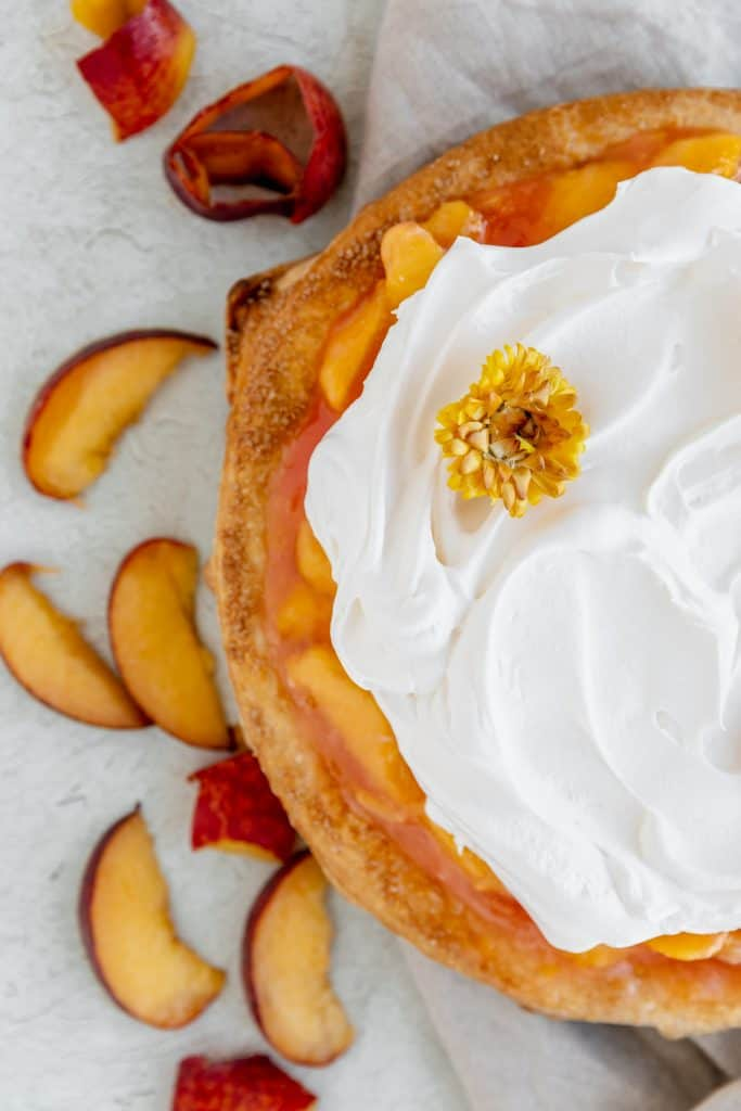 peaches and cream pie topped with cool whip