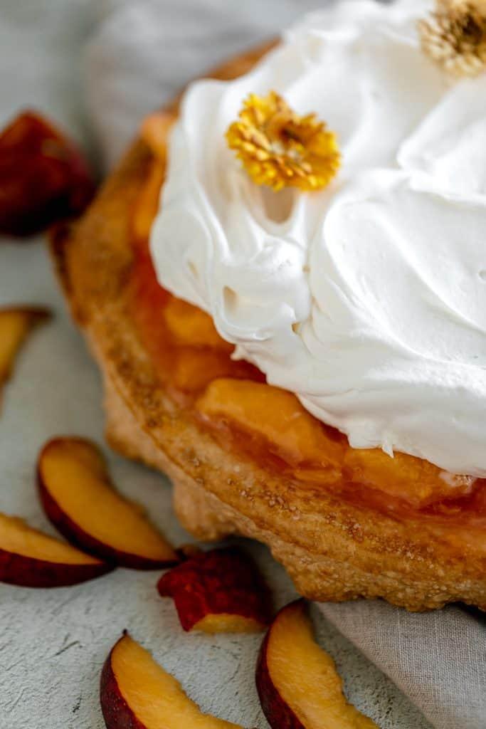 close up of peaches and cream pie
