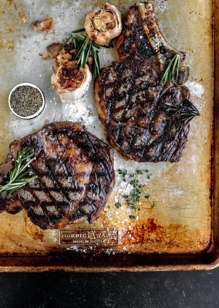 grilled bone in ribeye steaks with roasted garlic