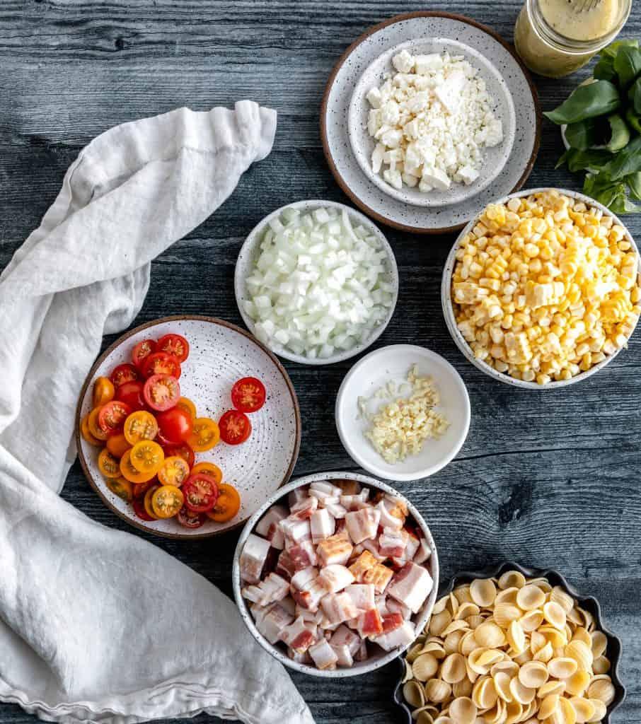 corn, bacon, onions, garlic, feta, tomatoes, basil and dressing