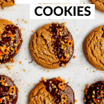 chocolate peanut butter cookies lined up on a baking sheet