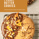 chocolate peanut butter cookie sitting on a cooling rack