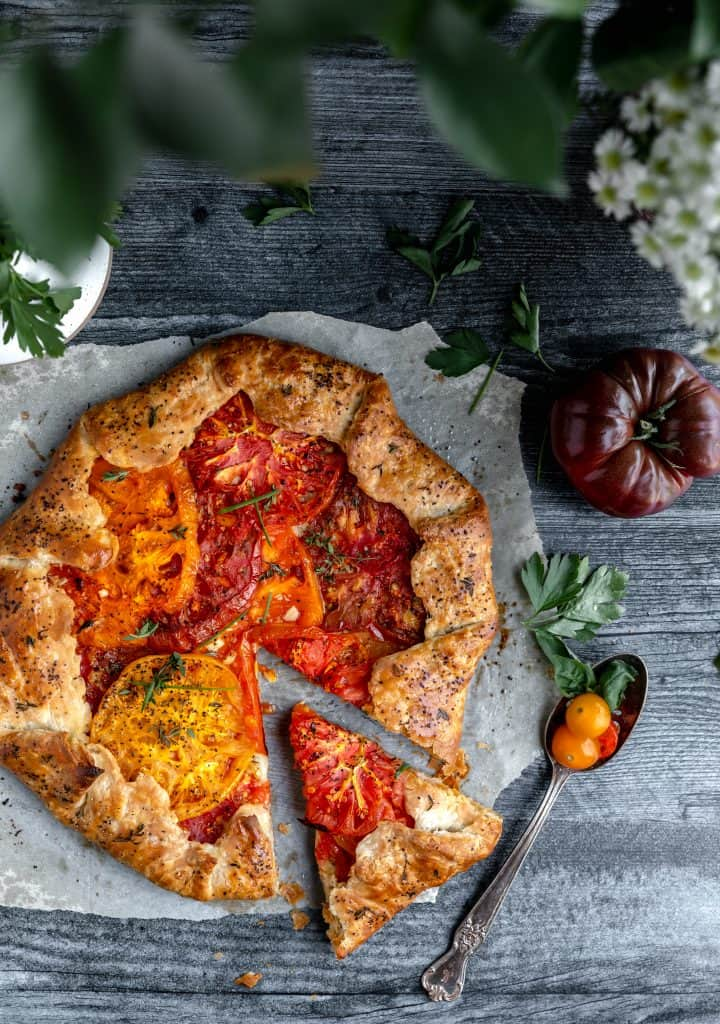 heirloom tomato galette with one slice cut out of it