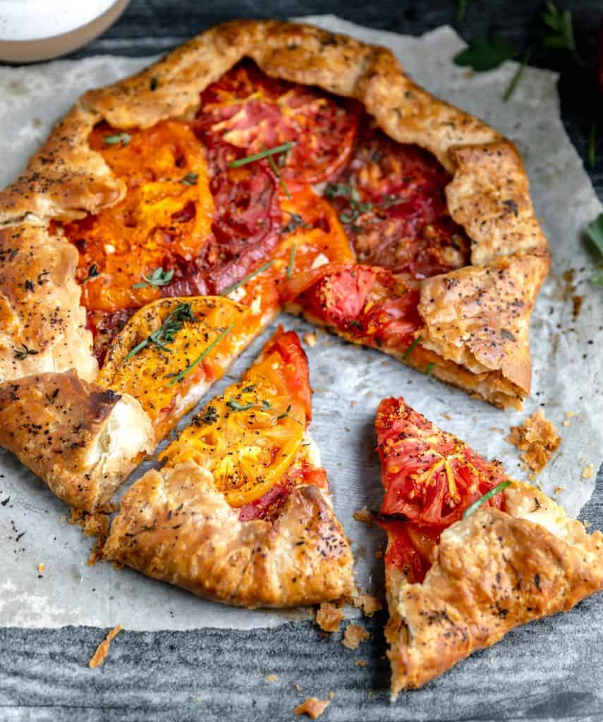 heirloom tomato galette with 2 slices cut out of it
