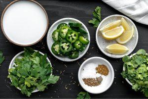 jalapenos, parsley, cilantro, lemons, coconut milk, cumin, salt and caraway seeds
