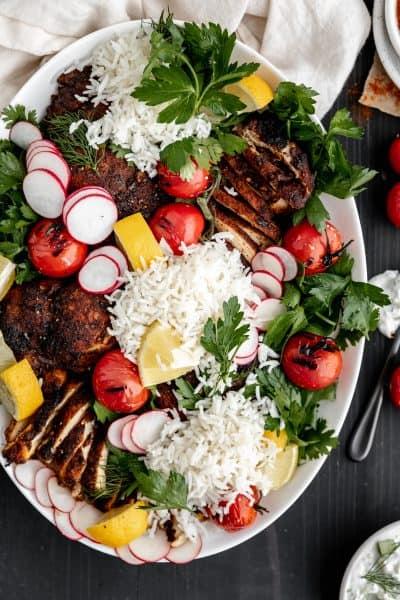Chicken shawarma platter with rice, herb salad and tzatziki sauce