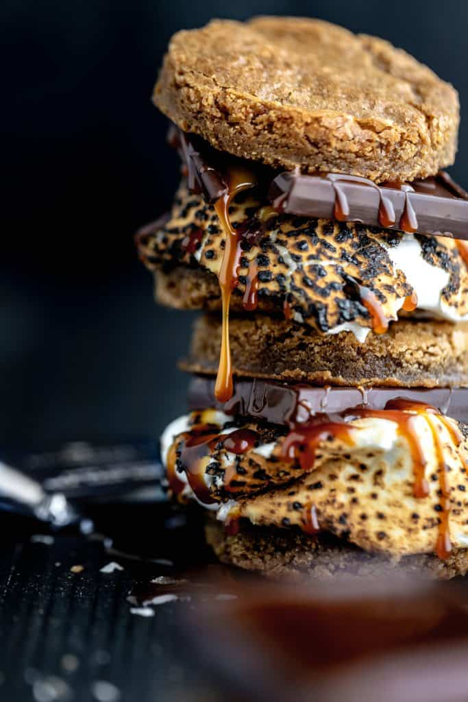 stack of brown butter graham cracker blondie s'mores with caramel dripping down the side