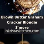 brown butter graham cracker blondie s'more with caramel being drizzled on top