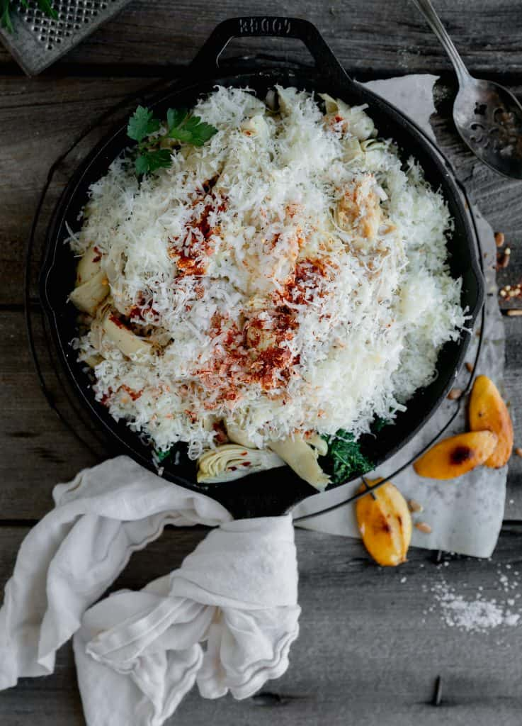 all the ingredients mixed together in a cast iron skillet before being heated in the oven