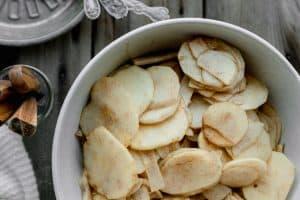 apple slices mixed with lemon, sugar and seasoning