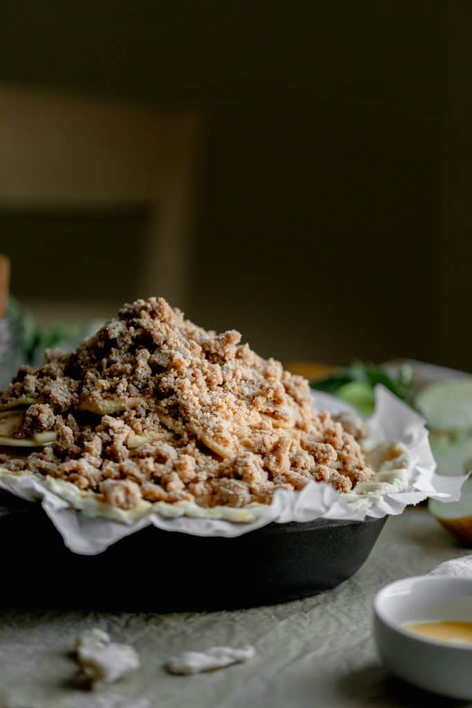a mound of streusel piled on top of the apple pie