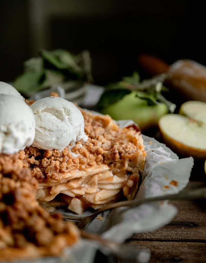 Dutch apple pie with scoops of vanilla ice cream on top
