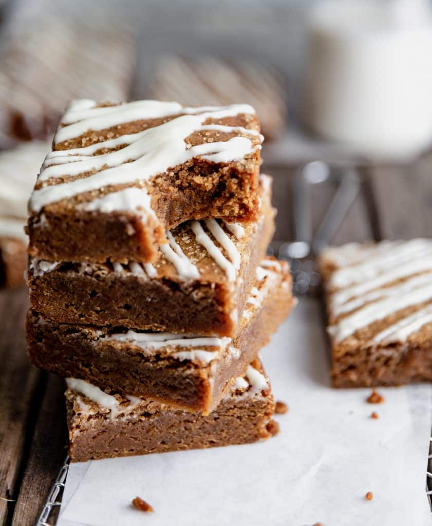 a stack of molasses blondies with a bite taken out of the top blondie