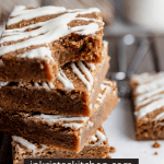 a stack of molasses blondies with a bite taken out of the top piece