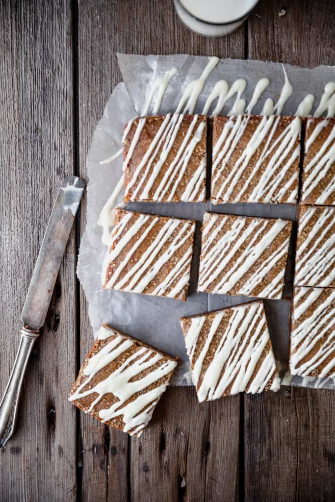 molasses blondies with white chocolate drizzled over the top