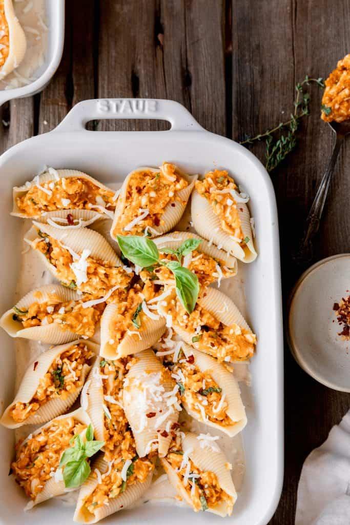 stuffed shells in a ceramic baking dish